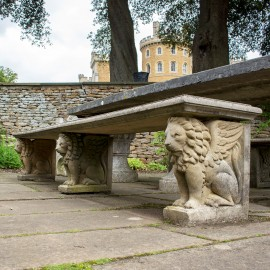 Chimera Stone Garden Bench by The David Sharp Studio shown in the gardens of Belvoir Castle