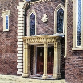 Tudor Gothic stone portico by the David Sharp Studio