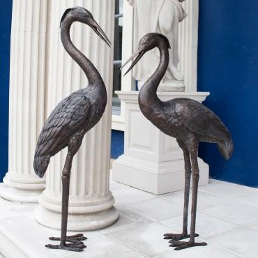 Pair Of Bronze Herons by the david sharp studio